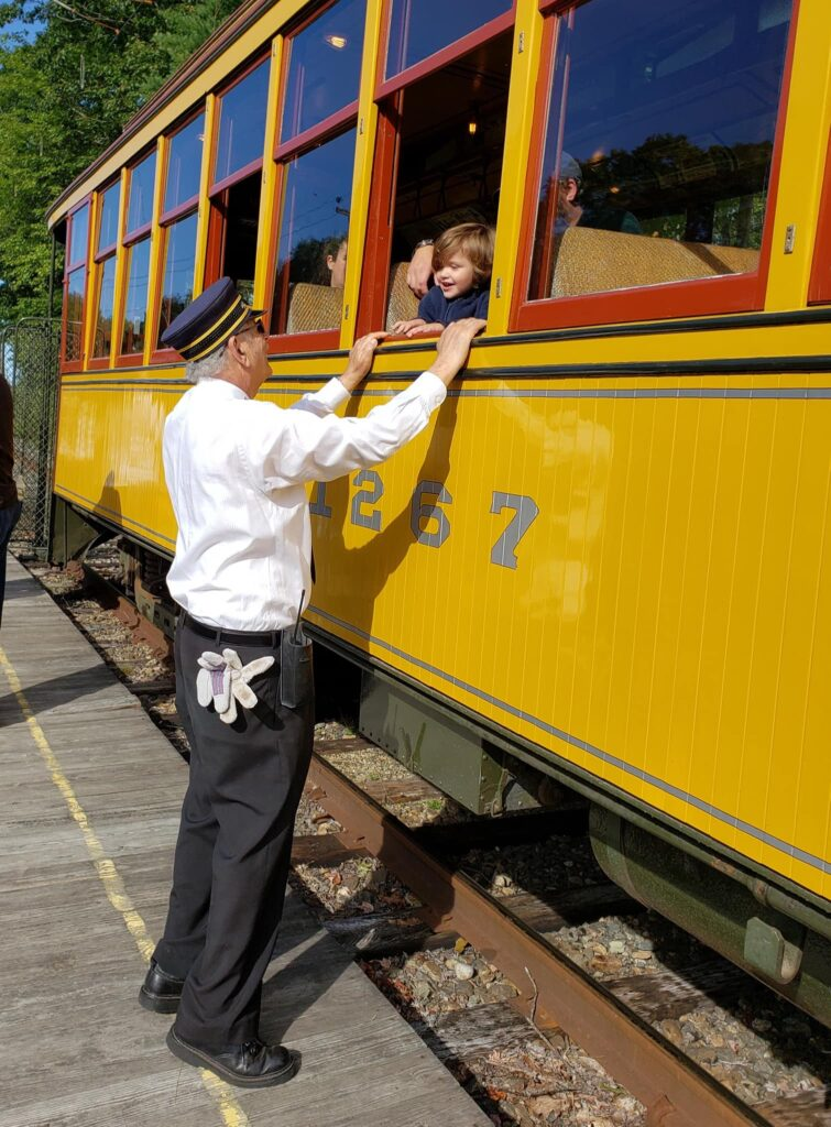 Museum - open today. A volunteer engages a young guest on the 1267. Private Heritage Railroad Trolley Rides