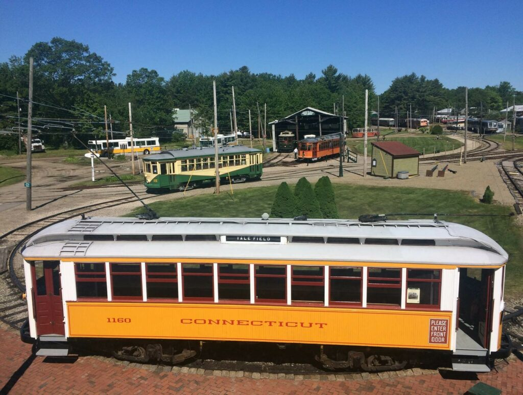 Trolleys parked throughout Seashore Trolley Museum's outdoor campus.