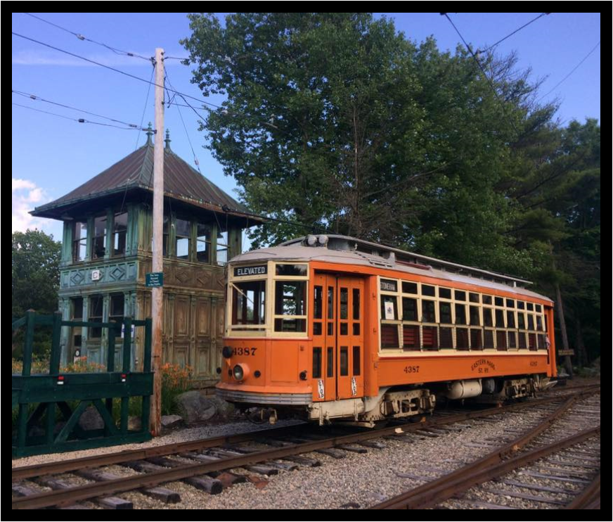 Antique trolley is parked alongside Tower C, a historic artifact built in 1901 from the Boston Elevated Railway.